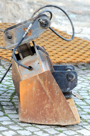 Close up of old rusty excavator bucket scooping Stock Photo