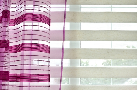 Modern window blinds and purple curtain