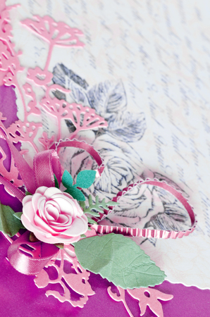 photo album: Decorative pink, purple paper cards with rose and leaves Stock Photo