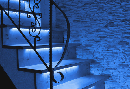 Blue night LED lighting wooden stairs with antique railing Banque d'images - 96859146