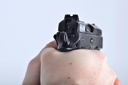 Hand aiming with pistol - view through the pistol sight