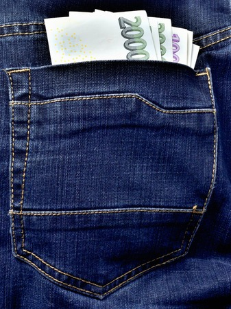 Czech banknotes in the back pocket of jeans, czech crowns