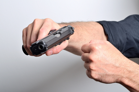 Man threats with gun, threating gesture isolated