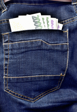Czech banknotes in the back pocket of jeans with belt, thousand, two thousand Czech crowns - vertical photo Stock Photo