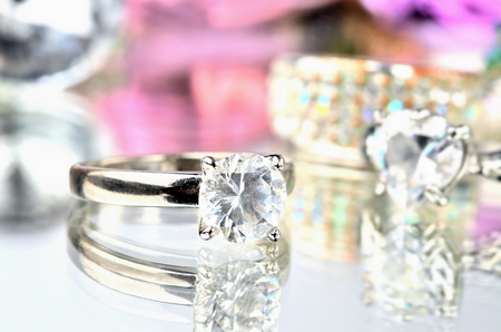 Close-up of artificial stone ring jewelery with reflection and another rings in background