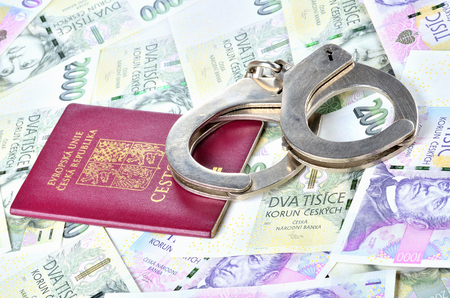 Czech republic passport and police handcuffs on banknotes - international arrest warrant concept Imagens