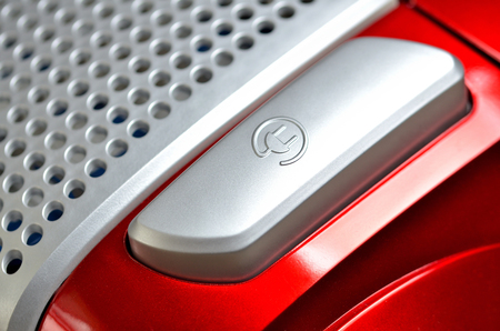 Close-up of power button on modern red vacuum cleaner Imagens - 123631274