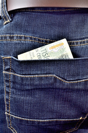 Money banknotes in the back pocket of jeans with belt, thousand, two thousand Czech crowns - vertical photo Imagens
