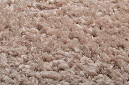 Texture of modern beige shaggy carpet - background Imagens