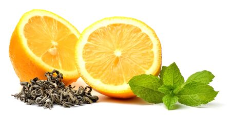 Half pieced lemon, fresh mint and black tea leaves isolated on white background. Close-up.