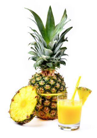 Fresh pineapple juice in glass and round slice isolated on white background