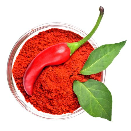 Chilli pepper, spice chilli powder and plant leaves isolated on white background.
