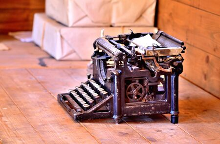 Old antique post typewriter from first world war in grunge looks on a wooden table