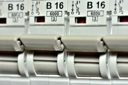 Detail of switches of modern circuit breakers designed for socket circuit to 16 amps max. Imagens