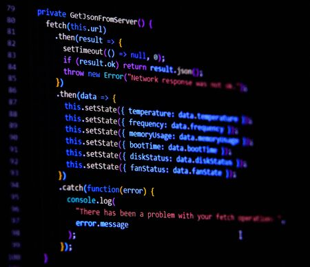 Modern Javascript, Typescript, Ecma script code with React Framework. Async with fetch. Software programming source code on computer screen..