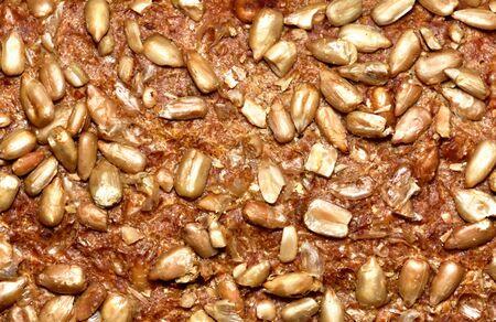 Bread crust texture with pumpkin seeds. Close-up detail.