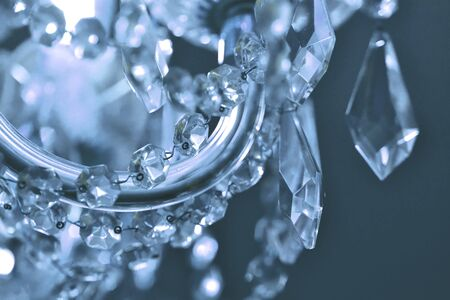 Detail of crystal ornaments on antique chandelier. Cold white color balance. Vertical photo Imagens