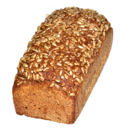 Loaf of sunflower bread with pumpkin seeds on crust isolated on white background