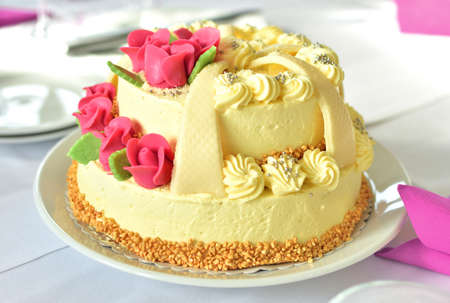 Beautifully decorated wedding cake covered with marzipan ornaments