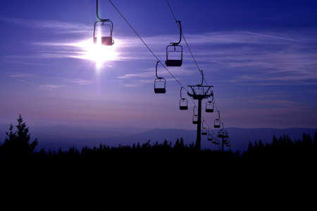 Ski chair lift in the mountains at blue night