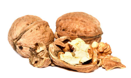 Crushed walnuts with nutshell isolated on white background