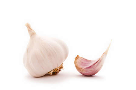 widely: Allium sp. Garlic is widely used for its pungent flavor. Stock Photo