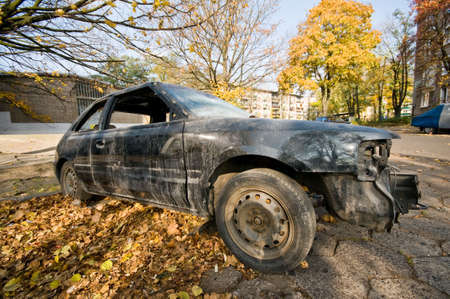 Old wrecked car on the street. Stock Photo
