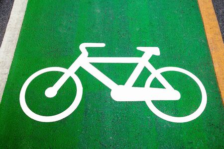 sport bike: Bike lane signs painted onto a green bike lane  Bike lane, road for bicycles