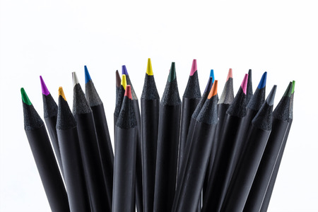 white color: Black color pencils Many different colored with white background.