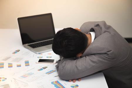 Businessman is sleeping on workdesk. Stock Photo