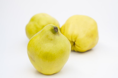 pectin: Quinces on white background Stock Photo