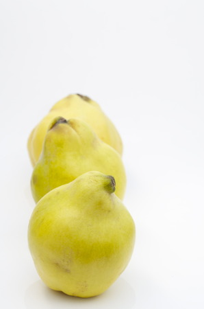 quinces: Quinces on white background Stock Photo