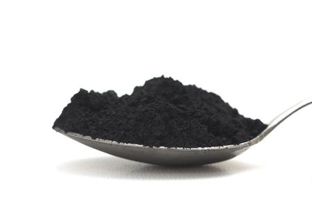 白い背景の上の活性炭 写真素材