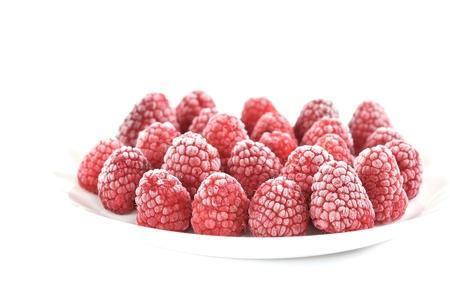 Frozen raspberry on the dish Stock Photo