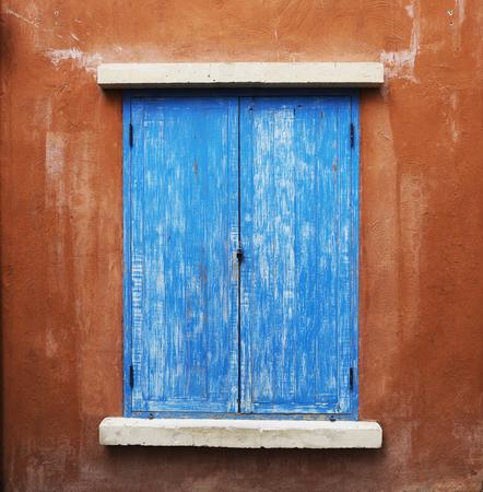 window shade: Blue window and brown wall