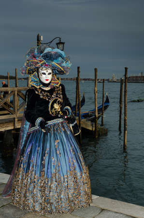 Masked person at the Venice Carnival 2013 photo