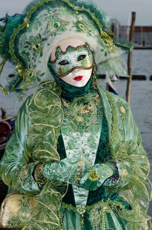 Costumed people at the Venice Carnival 2013 photo