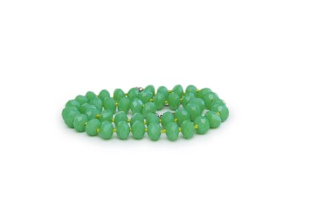 Necklace made of green beads isolated on white