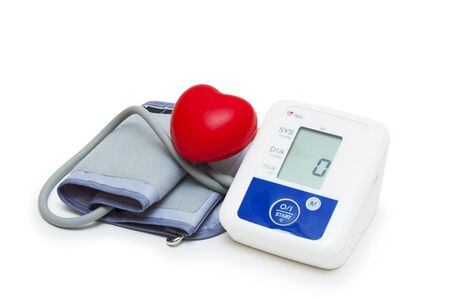 Digital blood pressure meter with love heart symbol on white background Stock Photo