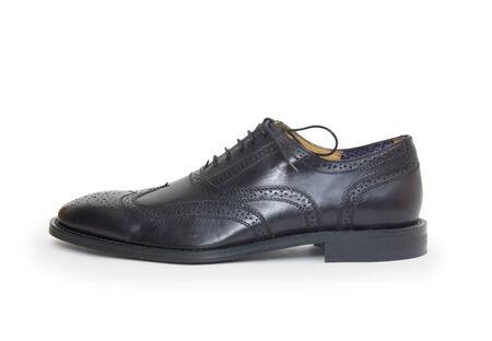 The black mans shoe isolated on white background.