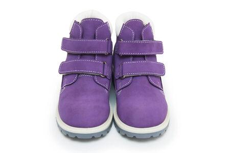 Purple children`s boots  Stock Photo