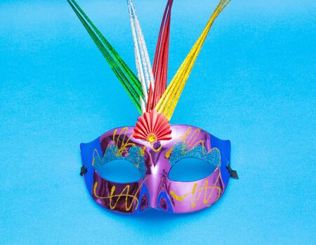 fasching: Carnival mask isolated on blue background