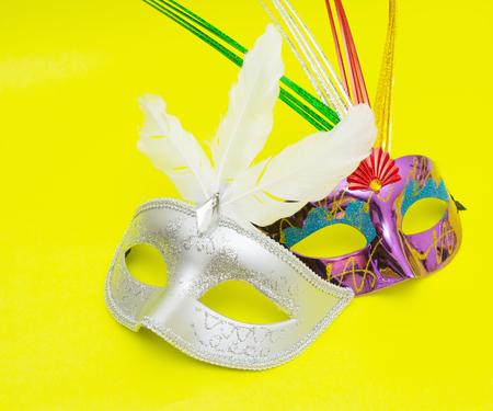 fasching: Carnival masks isolated on yellow background Stock Photo