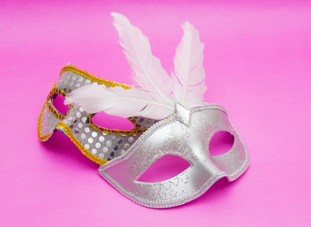 fasching: Carnival masks isolated on pink background Stock Photo