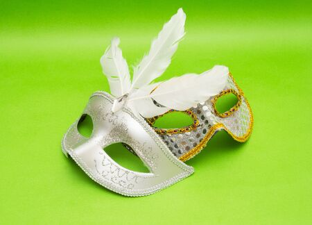 fasching: Carnival masks isolated on green background