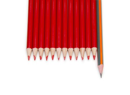 individualist: Black pencil standing out from the red pencils, isolated