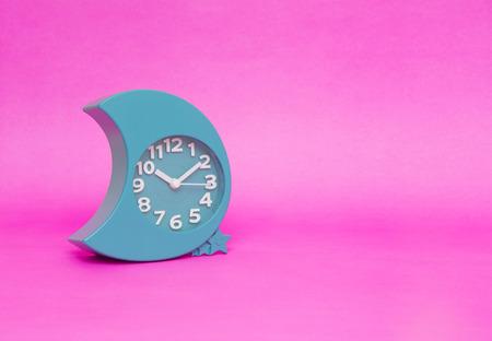 alarm clock on pink background Stock Photo