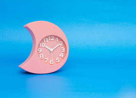 clock isolated on the blue Stock Photo