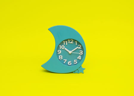 clock isolated on the yellow