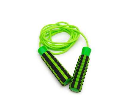 Green skipping rope for an exercise, isolated on white